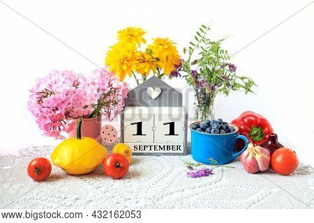 Calendar For September 11 : The Name Of The Month In English, Cubes With The Number 11, Ripe Vegetab