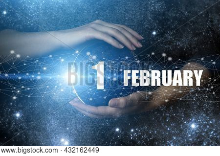 February 1st . Day 1 Of Month, Calendar Date. Human Holding In Hands Earth Globe Planet With Calenda