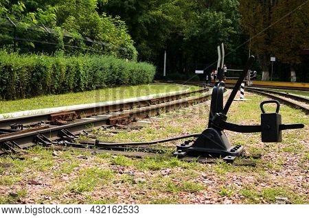 Close-up View Of Manual Railroad Switch. Black Railroad Direction Switch. Kyiv Children's Railway In