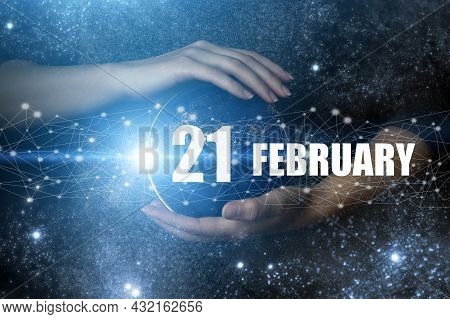 February 21st . Day 21 Of Month, Calendar Date. Human Holding In Hands Earth Globe Planet With Calen