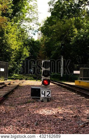 Railway Traffic Light For The Movement Of Trains Is Lit In Red. Railway Traffic Light At The Station