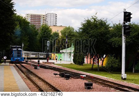 Kyiv, Ukraine-august 22, 2021:diesel Locomotive With Several Cars Approaches To The Station. Narrow