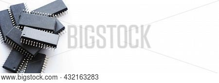 Panoramic Banner Pile Of Integrated Circuit Chip On White Background With Copyspace. Microchip Type