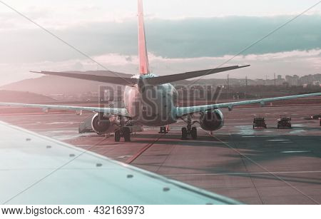 Aircraft in airport landing gear with power supply in the airport parking. Transportation theme