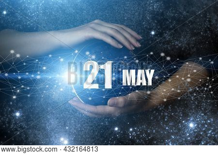 May 21st . Day 21 Of Month, Calendar Date. Human Holding In Hands Earth Globe Planet With Calendar D