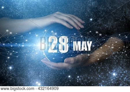 May 28th. Day 28 Of Month, Calendar Date. Human Holding In Hands Earth Globe Planet With Calendar Da