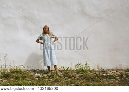 Three Quarter Front View Of Pretty Blond Teenage Girl On White