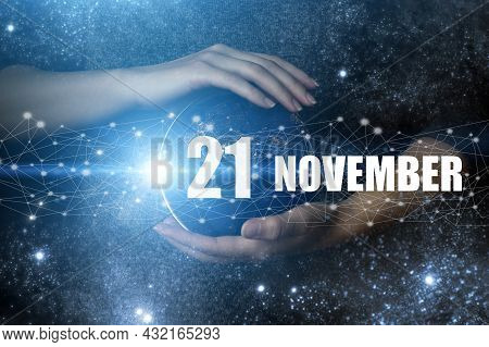 November 21st . Day 21 Of Month, Calendar Date. Human Holding In Hands Earth Globe Planet With Calen