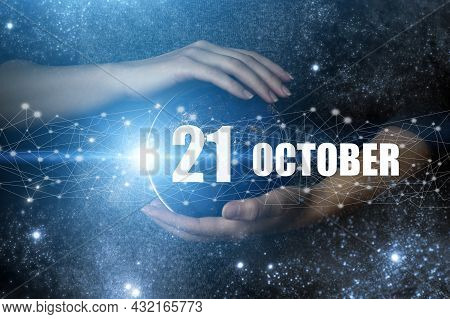 October 21st . Day 21 Of Month, Calendar Date. Human Holding In Hands Earth Globe Planet With Calend