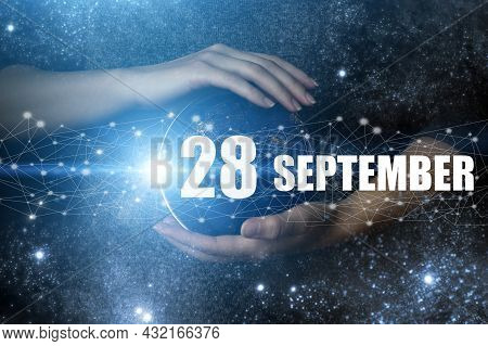 September 28th. Day 28 Of Month, Calendar Date. Human Holding In Hands Earth Globe Planet With Calen