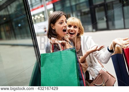 Group Of Women Friends Shopping In The City And Having Fun