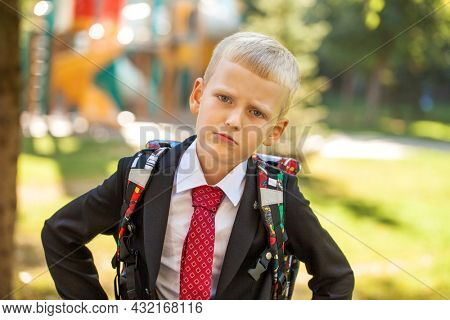 First grader, portrait of a young handsome boy in school uniform