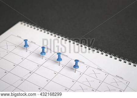 Blue Pins On Four Days In A Week On A Calendar. Friday, Saturday And Sunday Crossed Out. Four Day Wo