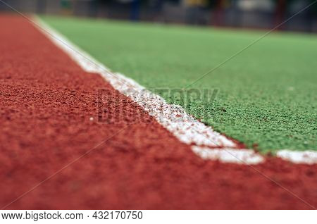 Close-up Of An Empty Soccer Field With Artificial Turf. The Field For Sports Games With A Coating Of