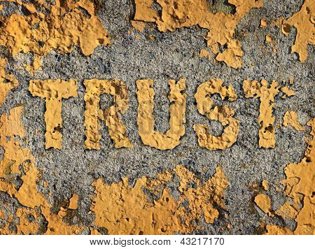 poster of Losing trust and deteriorating integrity as a business concept represented by old fading yellow cracked paint on a rough cement wall showing the business metaphor of lost morality and illegal financial bank and stocks transactions.