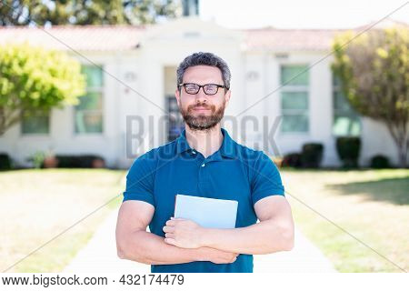 Dreamy Positive Man In Glasses With Paper Sheet, Education