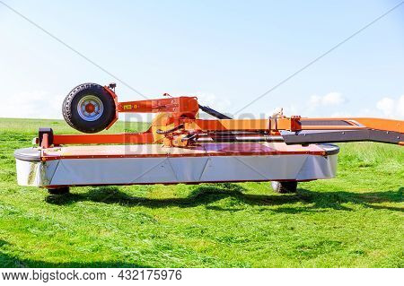 A Red Rotary Mower Cut The Grass In The Field. Clear Field. Drying Hay In The Field.