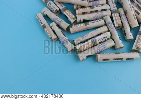 Ukrainian 500 Banknotes In Rolls On A Blue Background.