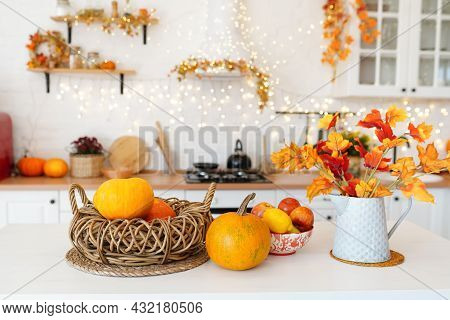 Colorful Autumn Still-life On A Kitchen Table. Pumpkin, Bouquet Of Maple Leaves And Apples