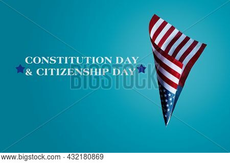 the text constitution day and citizenship day, and a flag of the United States against a blue background