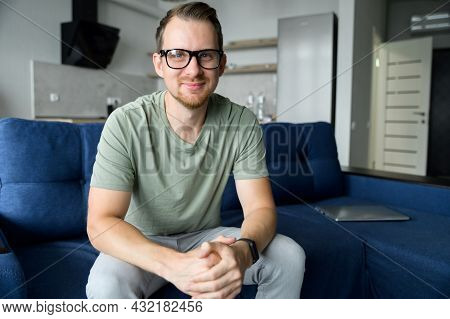 A Head Shot Of A Young Happy Man In Casual Shirt Talking Via Video Call, Mentor, Trainer Conducts We