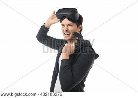 Side View Of Young Man With Gamepad In Hand And Vr Goggles On Head, Looking At Camera With Excitemen