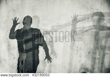 White Textured Wall With Human Shadow. Silhouette Of A Man With Spread Hands. Abstraction, Horror, T