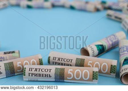Ukrainian 500 Banknotes In Rolls On A Blue Background. Ukrainian Money.