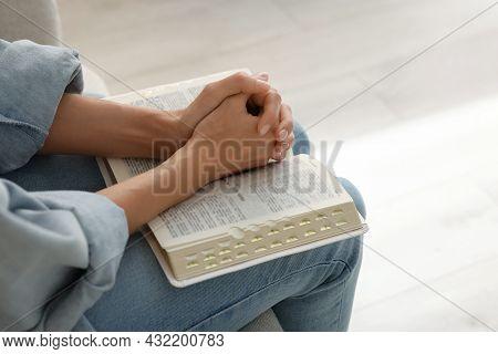 Religious Woman With Bible Praying Indoors, Closeup