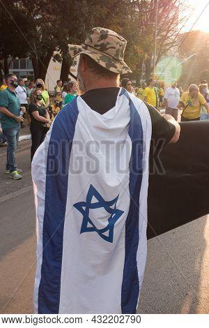 Brasilia, Df Brazil, September 6, 2021: Demonstrator Wearing An Israeli Flag While Protesting Agains