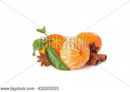 Mandarins And Cinnamon Isolated On White Background