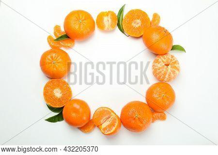 Circle Of Tasty Mandarins On White Background