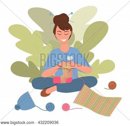Smiling Woman Is Knitting A New Sock From An Old Scarf. Secondary Use Of Old Clothes. Concept Of Rec
