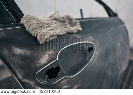 Close Up Of Cleaning Rag Lying On Car Window