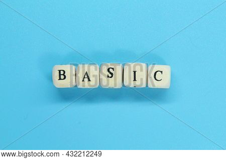 Small Wooden Cubes With The Word Basic