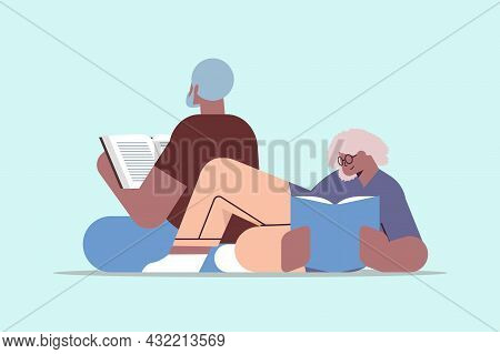Senior Couple Reading Books Old African American Man And Woman Family Spending Time Together Relaxat
