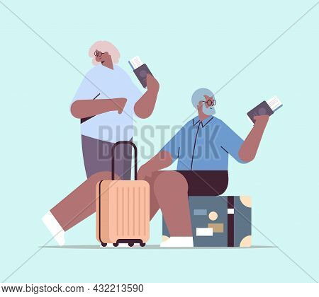 Elderly Couple Of Tourists Grandparents With Luggage Holding Passports And Tickets Ready To Boarding