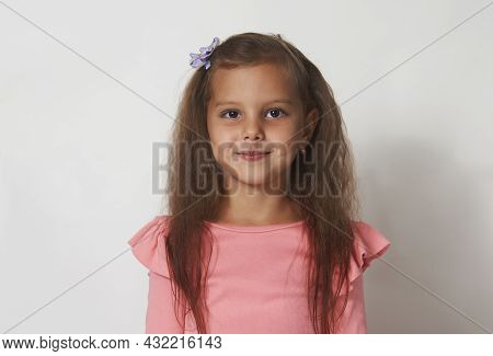 Beautiful Girl Portrait On A White Background With Copy Space