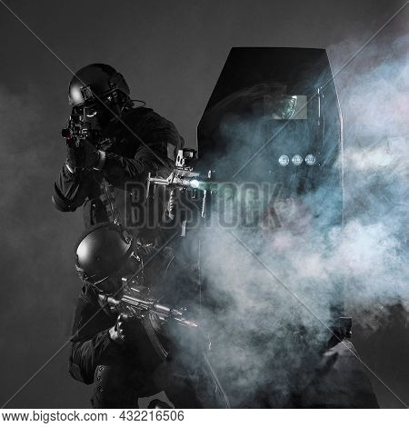 A Special Forces Group Armed With Special Weapons Acts In The Dark And Is Protected By A Shield With