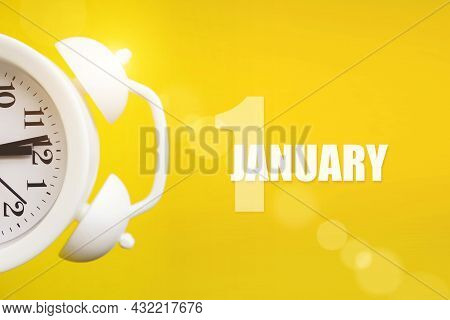 January 1st . Day 1 Of Month, Calendar Date. White Alarm Clock On Yellow Background With Calendar Da