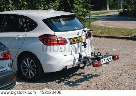 Netherlands - Aug 27, 2019: Rear View Of Bmw Car With Bike Carriage In The Rear
