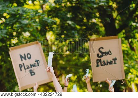 Closeup View Of A Homemade Signs, Saying There Is No Planet B, Held By Eco-activists During A March