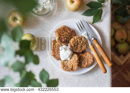 Apple Fritters For Breakfast. Delicious And Hearty Pancakes With Sour Cream And Fresh Apples. Top Vi