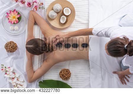 Spa Stone Massage, Beautiful Woman Getting Hot Stones Massage, Beauty Treatments Concept. Top View.