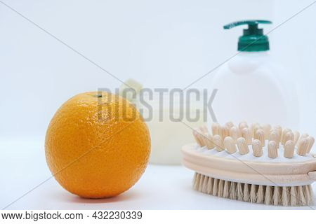 Orange And Double-sided Massage Brush For Body, Crem And Body Scrub On White Background. Anti-cellul