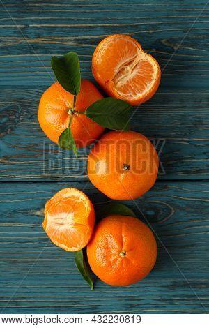 Tasty Fresh Mandarins On Rustic Wooden Table