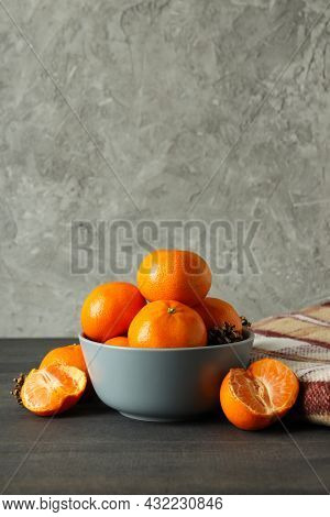 Bowl With Mandarins And Plaid On Dark Wooden Table