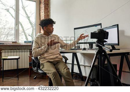 Millennial African American Male Trader Shoot Webinar On Camera About Online Investment On Stock Mar