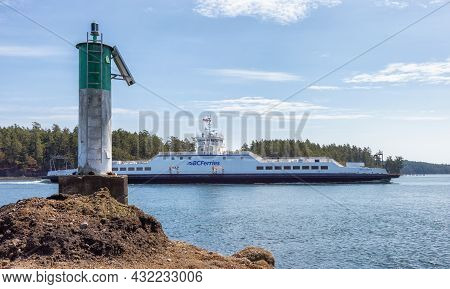 Victoria, Vancouver Island, British Columbia, Canada - August 18, 2021: Bc Ferries Boat Arriving At