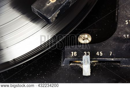 Black Vinyl Record Spinning On The Turntable With The Speed Selector Set To 33 Rpm. Vintage Audio Eq